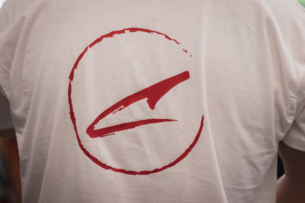 A white t-shirt with a red C logo on it