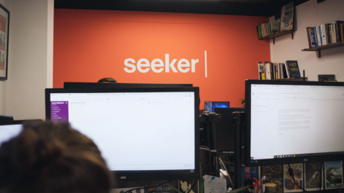 The Seeker office with the company logo on the wall